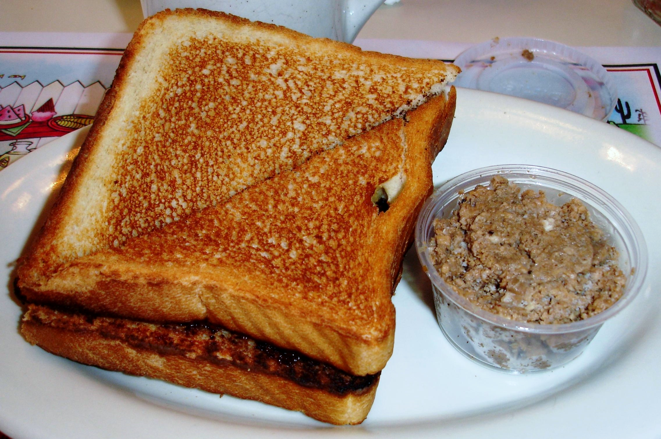A traditional French Canadian breakfast: creton and toast. Creton is a cold pork spread.