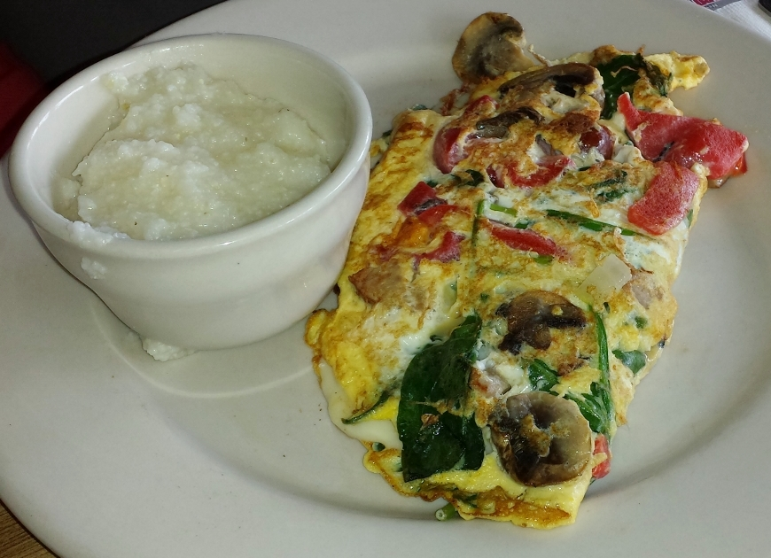 Daphne's Omelette: roasted peppers, sausage, mushrooms, spinach, cheese. Grits are always available to sub for home fries.