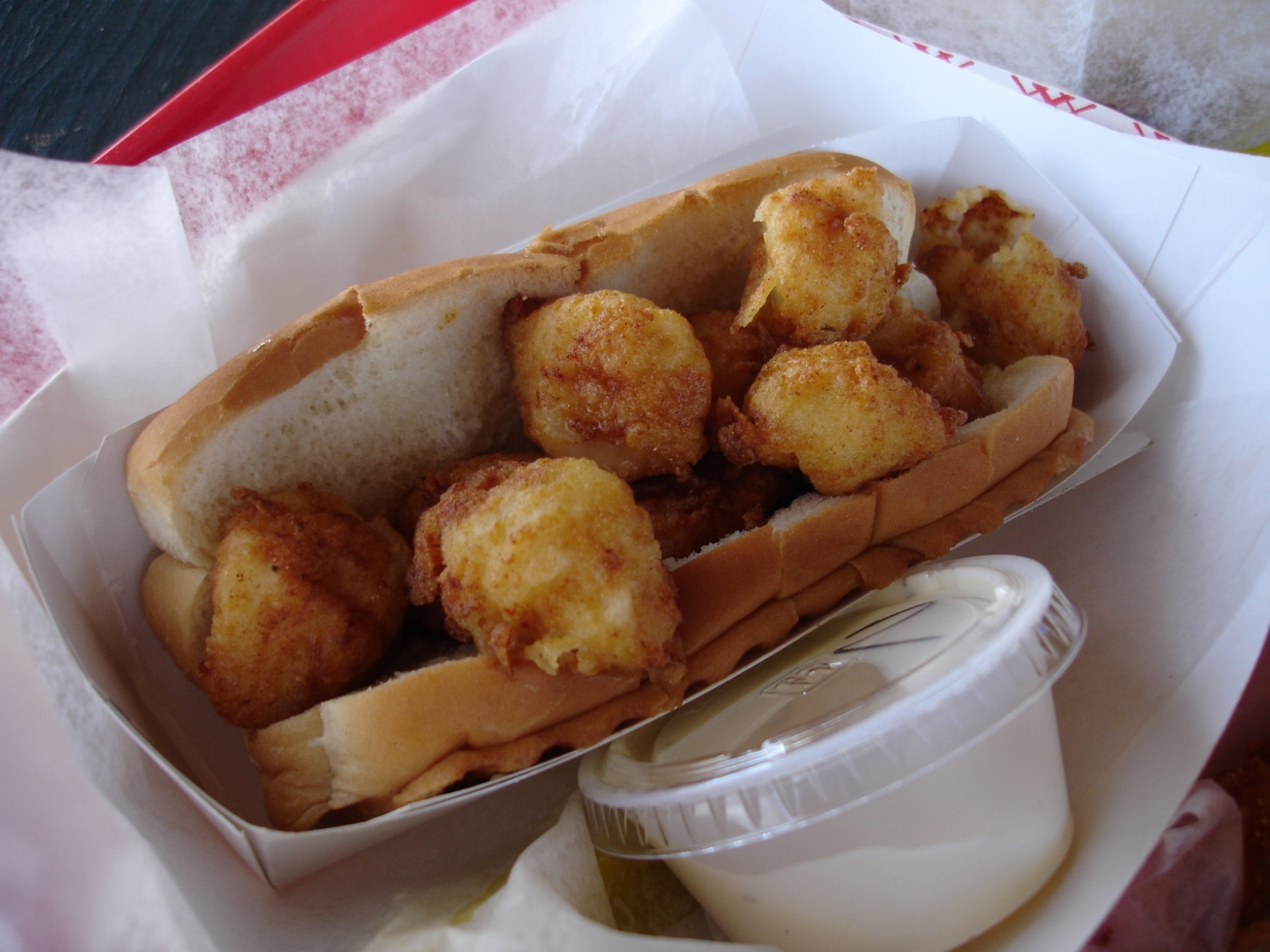 The fried scallop roll, while not as overflowingly apportioned as its coastal cousins, is, like all the seafood served here, made with fresh scallops, expertly fried.