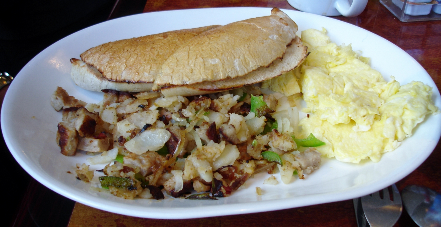 Sausage hash with scrambled eggs and a grilled Woody roll