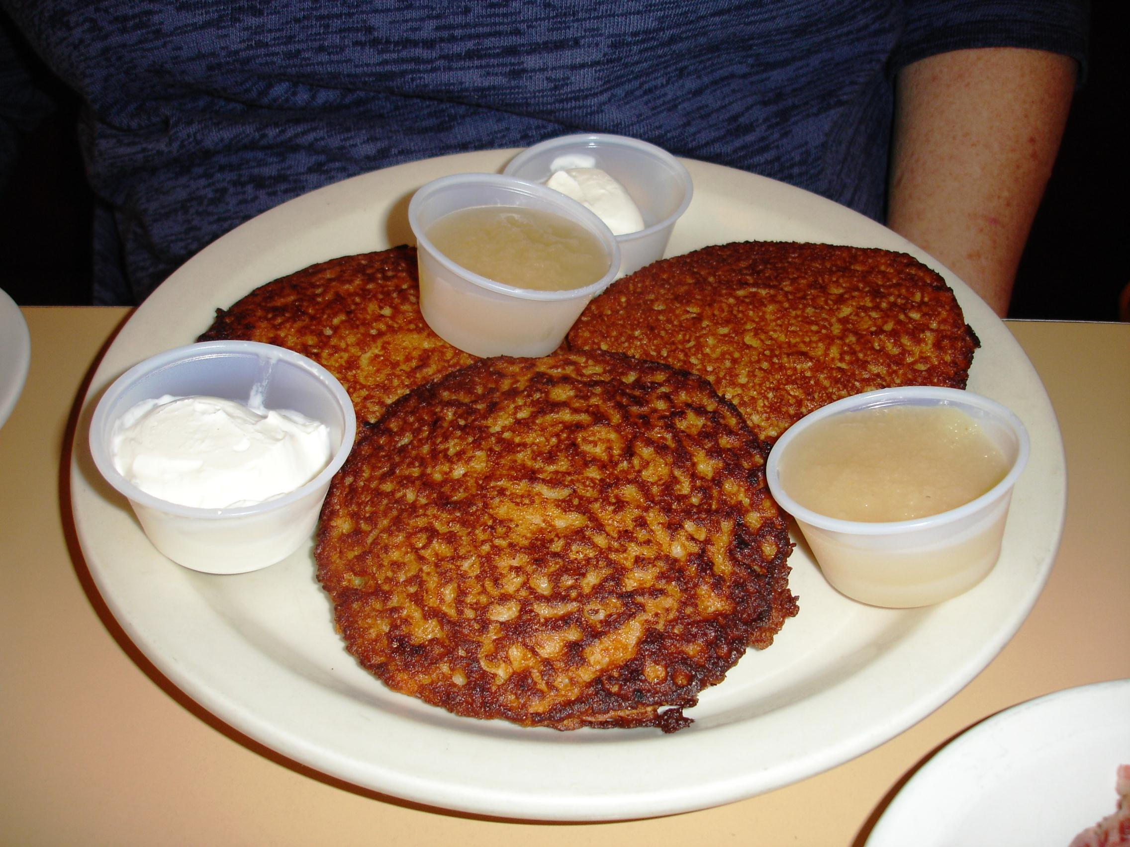 Potato pancakes are crisp, moist within, and will please fans of the batter-style of latkes.