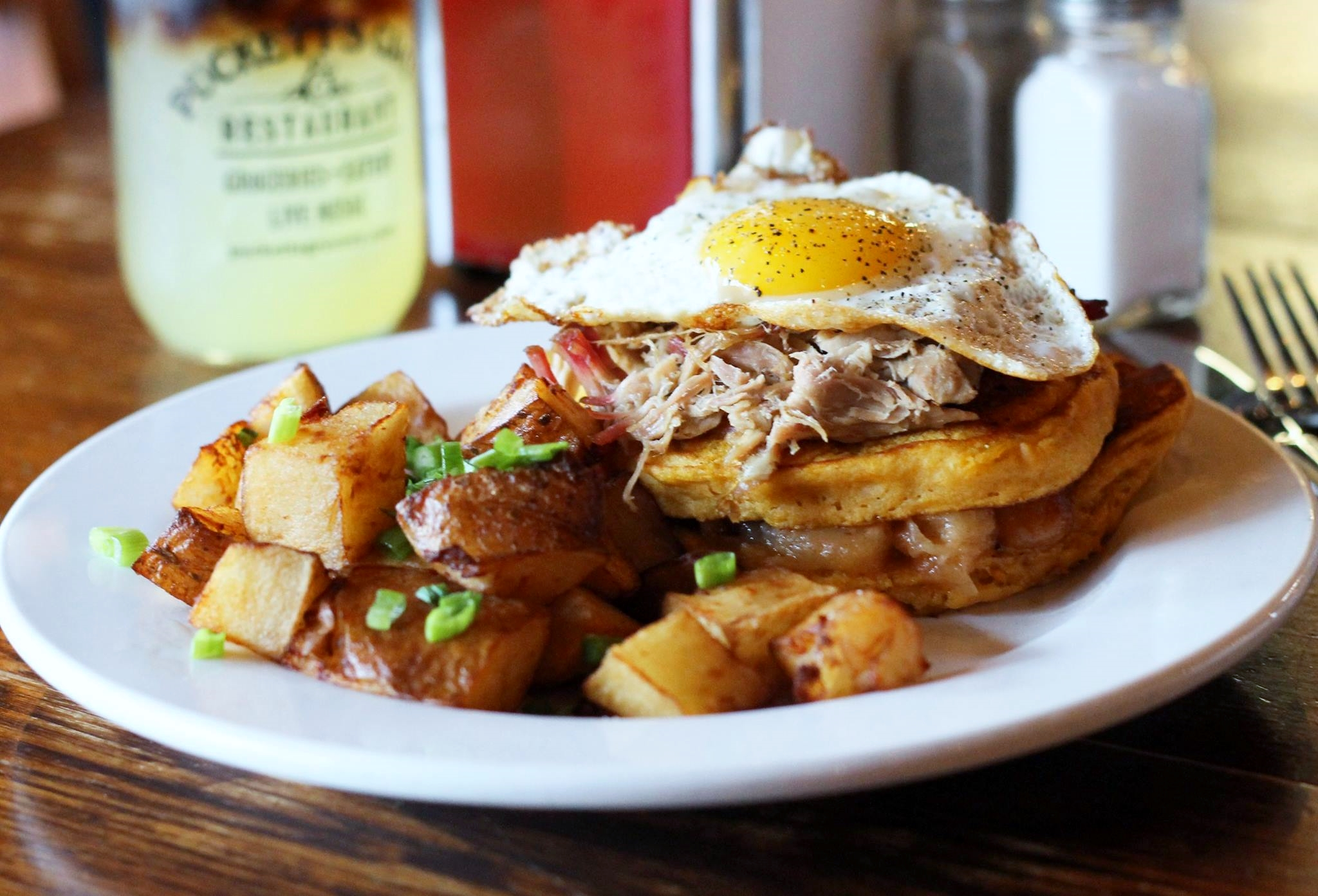 The incredible Southern Stack: slow-smoked pulled pork over sweet potato pancakes and fried apples, topped with a fried egg