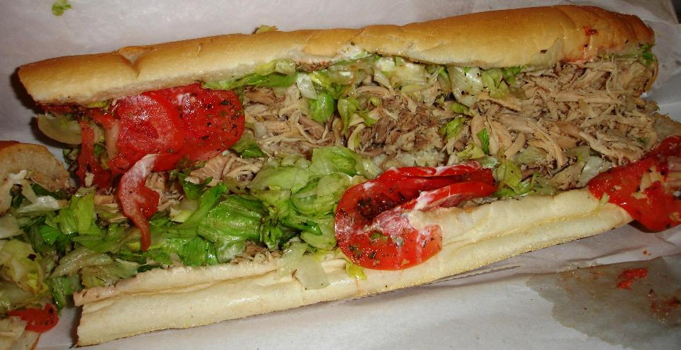The plain turkey sub is anything but! The sandwich doesn't hold enormous quantities of turkey, but there is an enormous amount of roasted turkey taste.