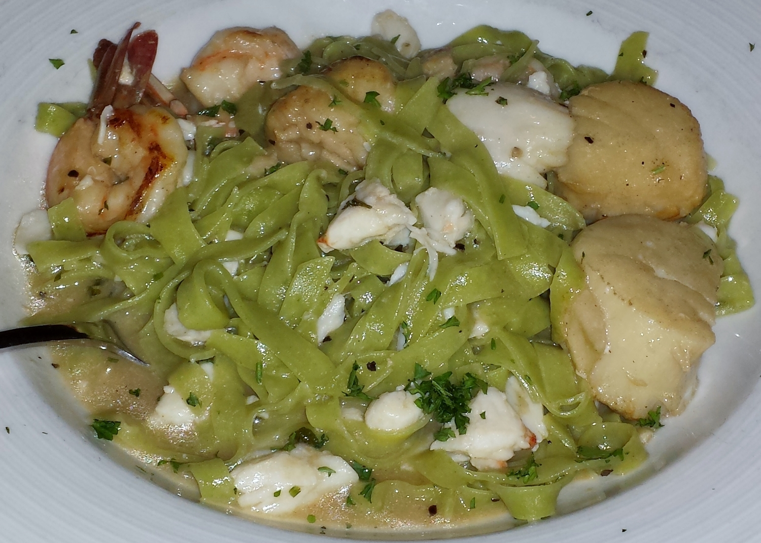 A special seafood pasta came loaded with lump crab, shrimp, and scallops, in a punchy seafood sauce.