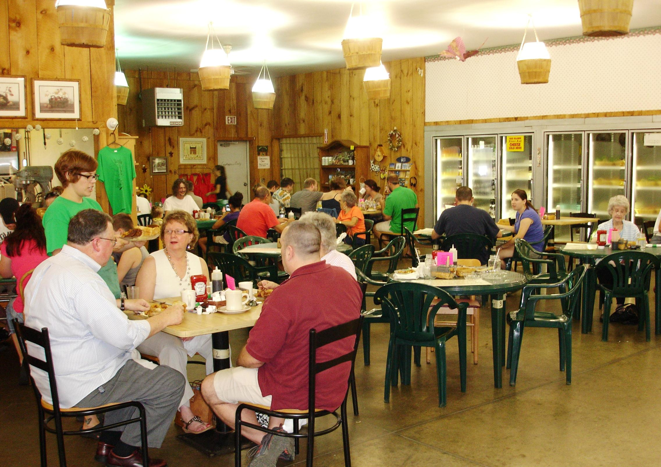 Tables are scattered across a section of the market. Weekend brunch is very popular, and table waits are not uncommon.