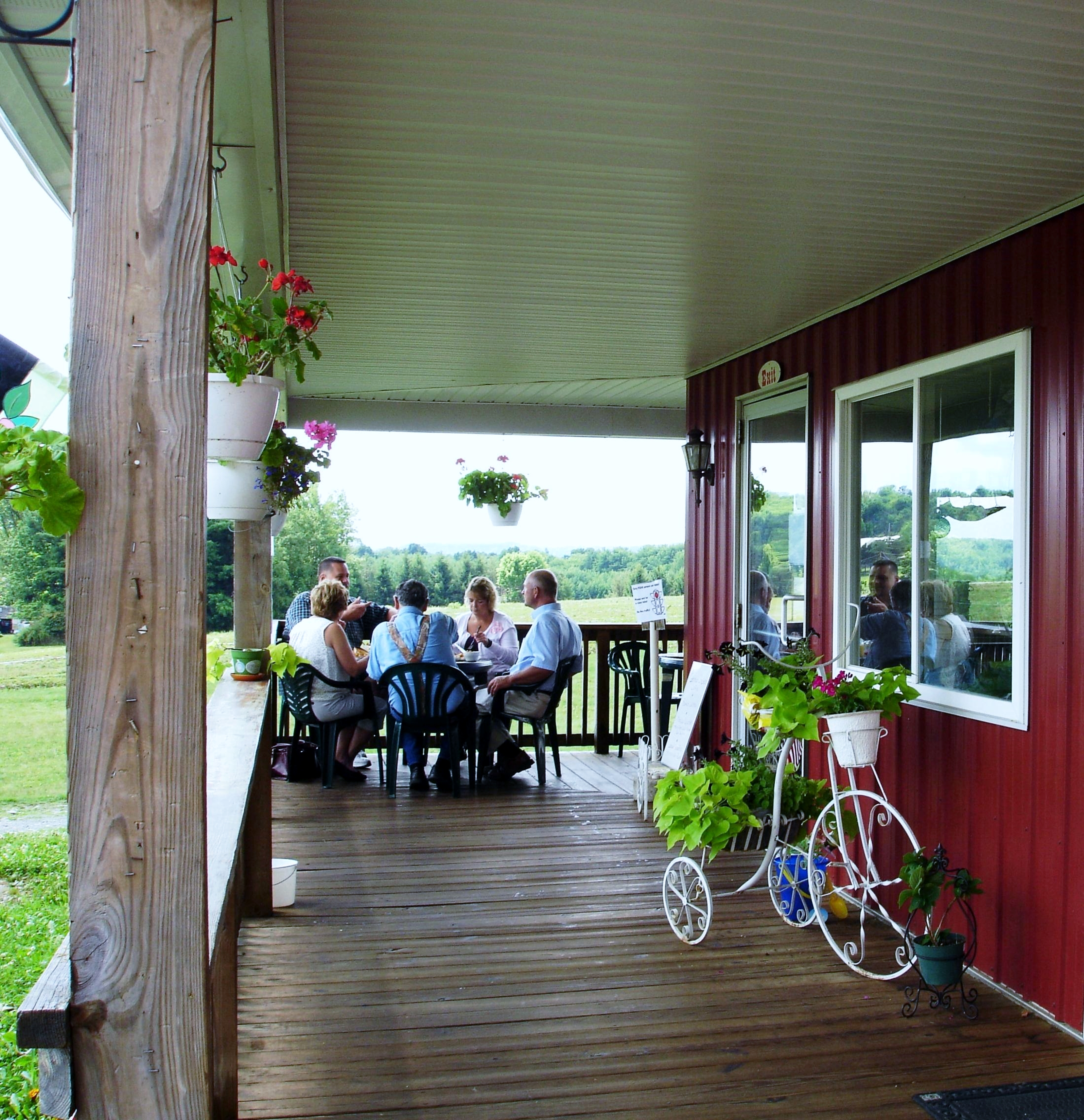 Prefer to dine in the fresh air with a view of the farm? There are tables on the porch.