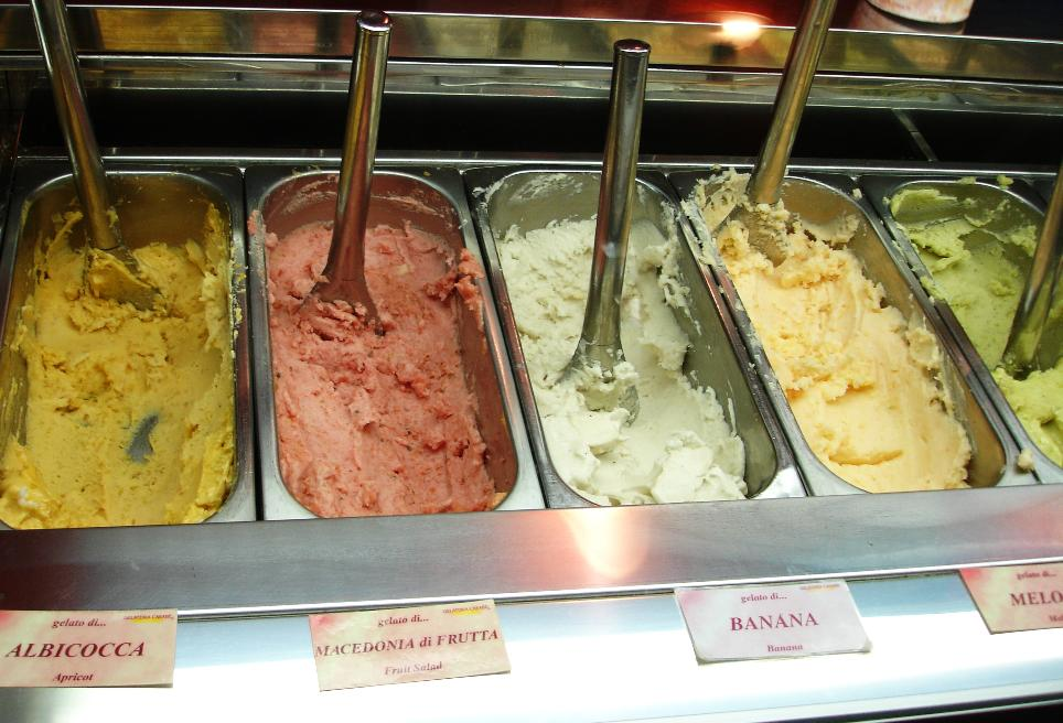 "From the left: apricot, ""fruit salad,"" banana, melon, and fig. It's all called ""gelato,"" but the quantity of dairy greatly varies, depending on the flavor and gelateria. Fruit flavors tend to have less milk, and the flavors we tried had little or none; they seemed to be, essentially, sorbets or cremolatas."