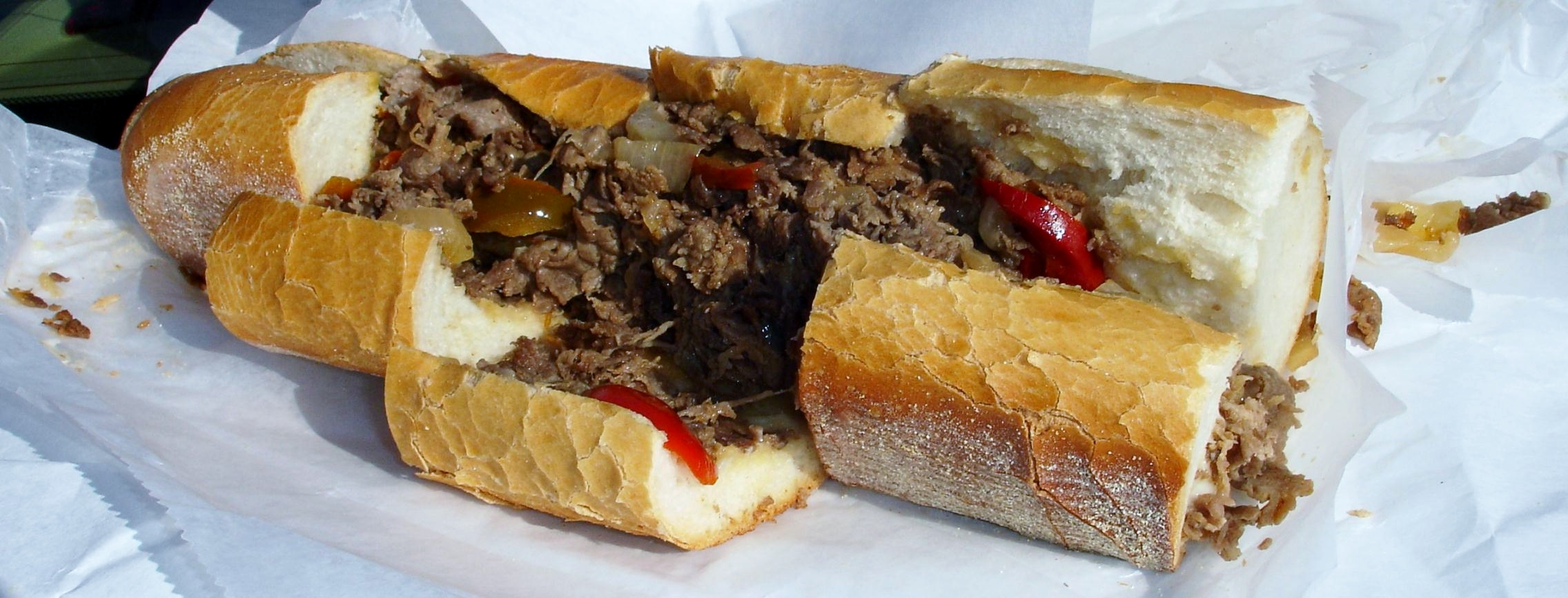 A Big Daddy cheese steak adds cherry peppers and fried onions to the meat and cheese.