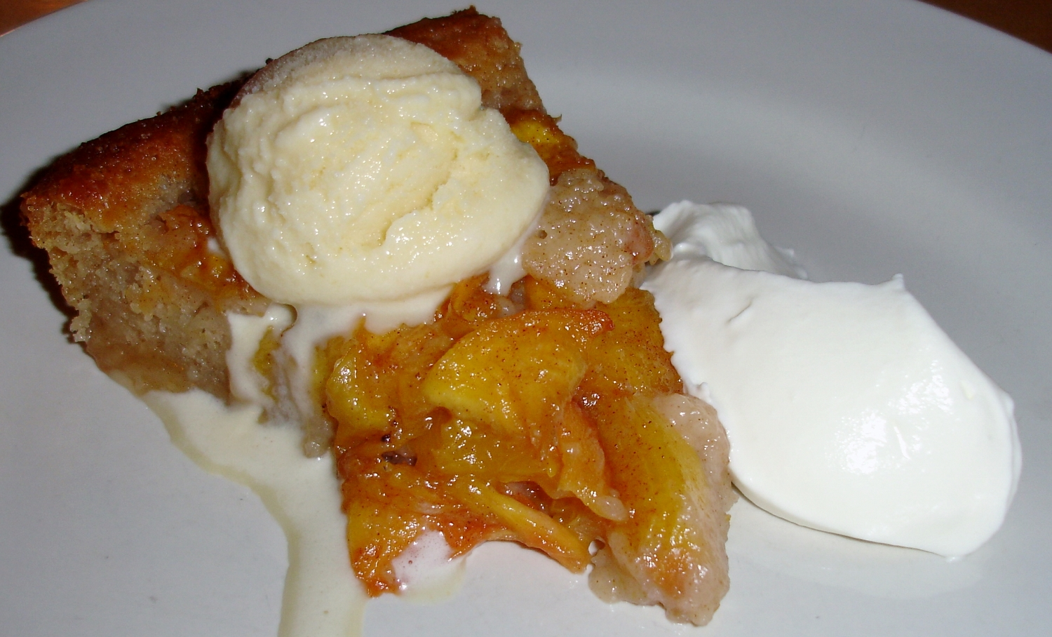 Peach cobbler with buttermilk brandy brown butter ice cream