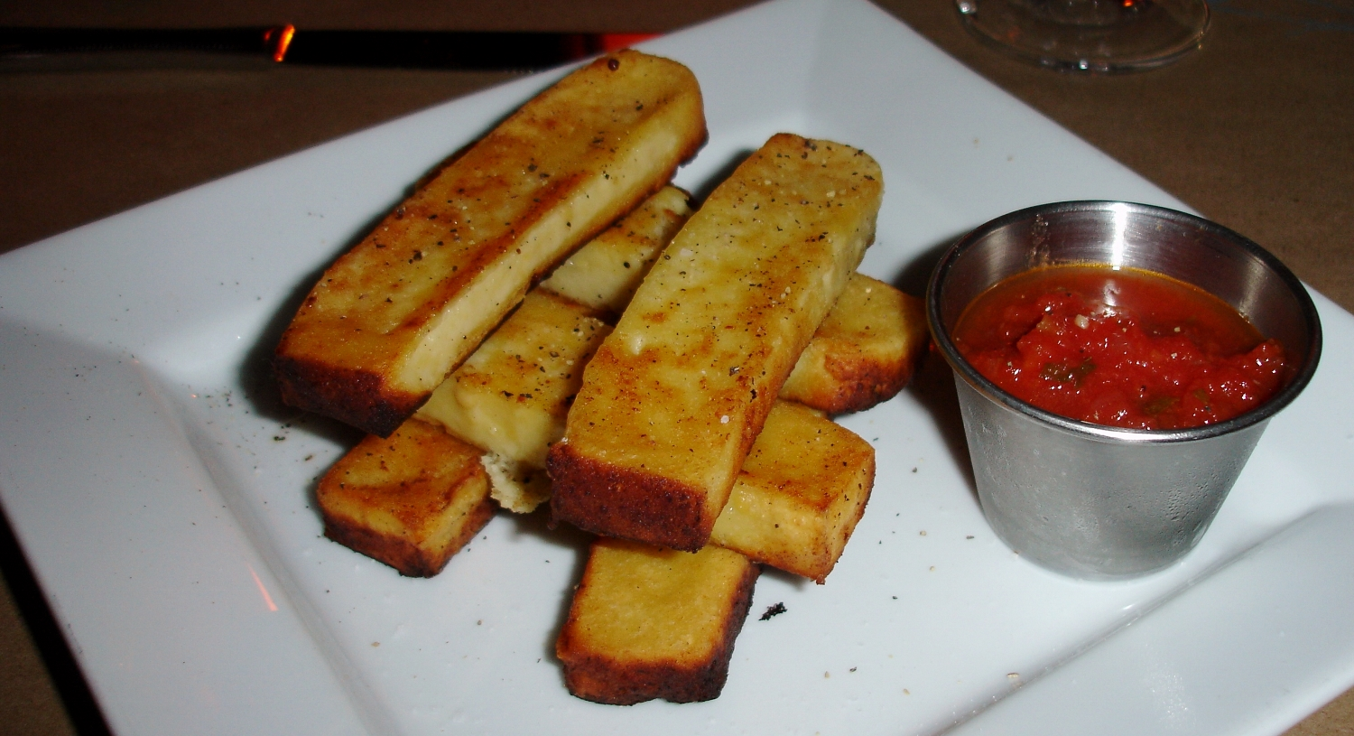 A starter of fried panelle (chickpea polenta) with fresh marinara would have been fine had they not been badly burned on the bottom. We're sure they'd have been replaced had we brought it to the attention of the house but we just didn't feel like making a fuss.