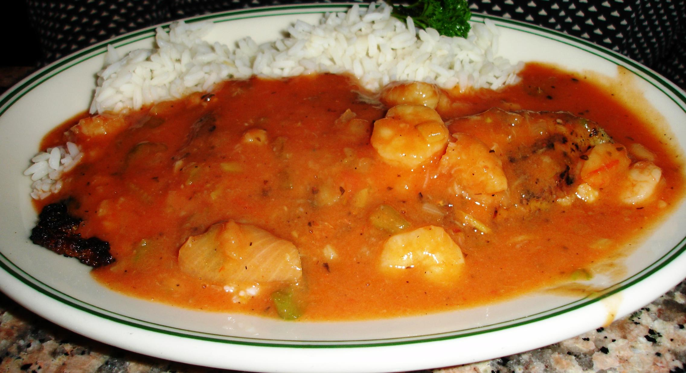 A filet of redfish is topped with shrimp Creole.