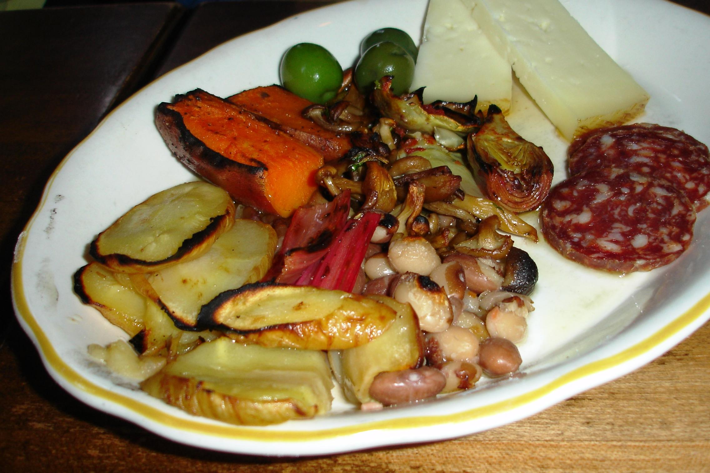 A selection of wood-roasted vegetables is featured on the antipasto plate.