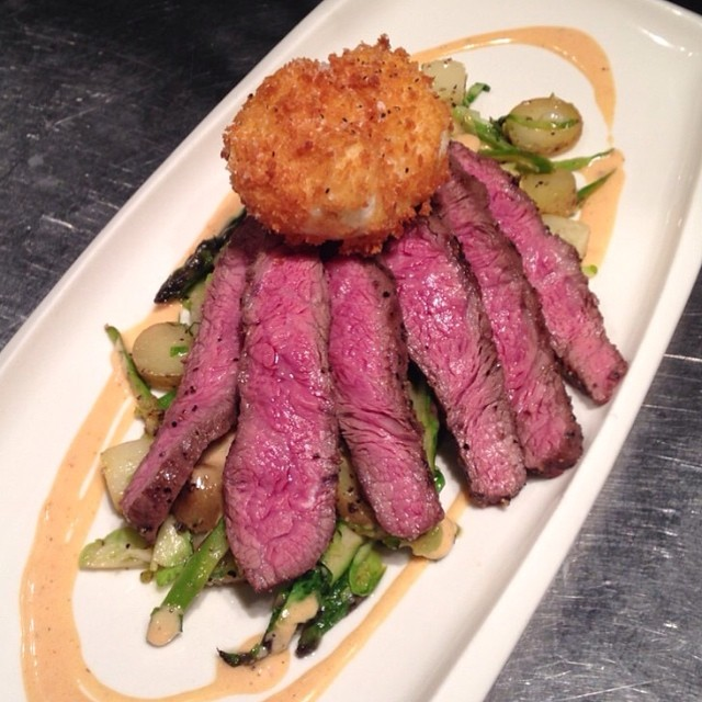 Flat iron steak with asparagus, potato, brussels sprouts hash, bbq hollandaise, and a deep fried poached Reinink Family Farms organic egg, as served at Le Chien Noir