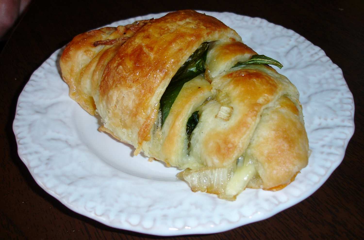 Hand-made croissant are filled with any number of good things to eat, like this one with spinach, onions, and cheese.