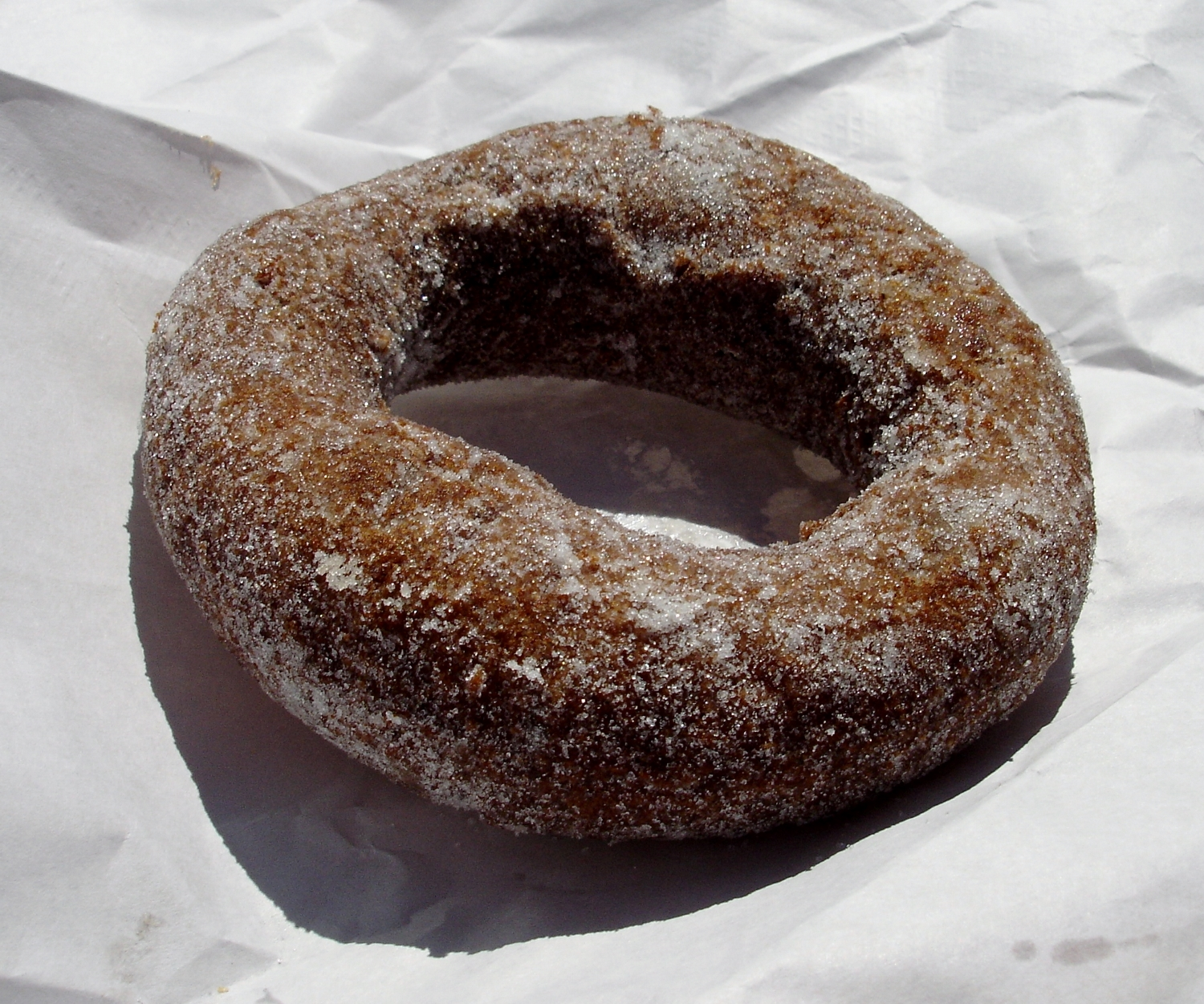 A sugared doughnut with a nice crunchy skin