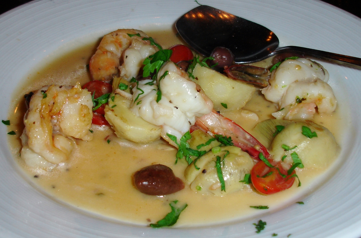 A shrimp appetizer special featured shrimp cooked not a moment too long, with tomatoes, pungent olives, and plenty of butter sauce that we were told would be a little spicy. It was not, but we enjoyed cleaning the plate with bites of warm bread.