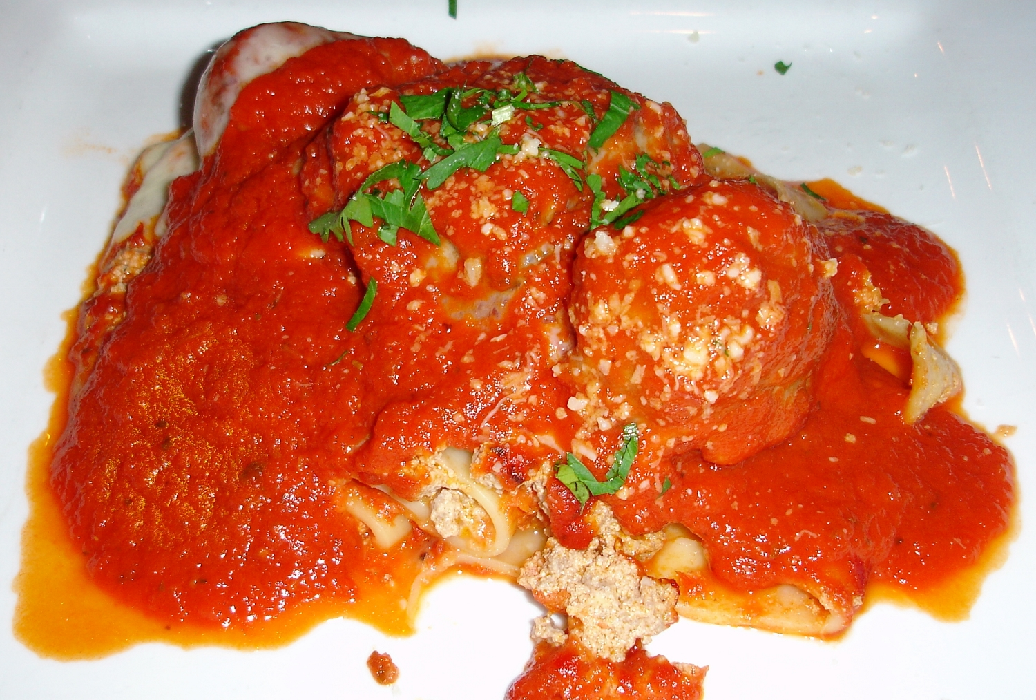 Lasagna is apparently made on the spot, garnished with a pair of excellent meatballs and  a well-spiced patty of  well-browned Italian sausage that tasted homemade.