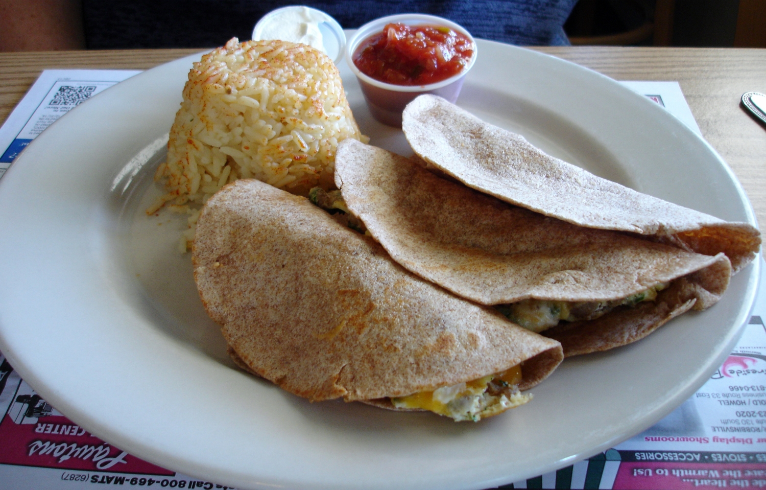Breakfast tacos, anothe breakfast special: the wheat tortillas are filled with sausage, eggs, cilantro, salsa, and cheddar. Sue gave a big thumbs up.