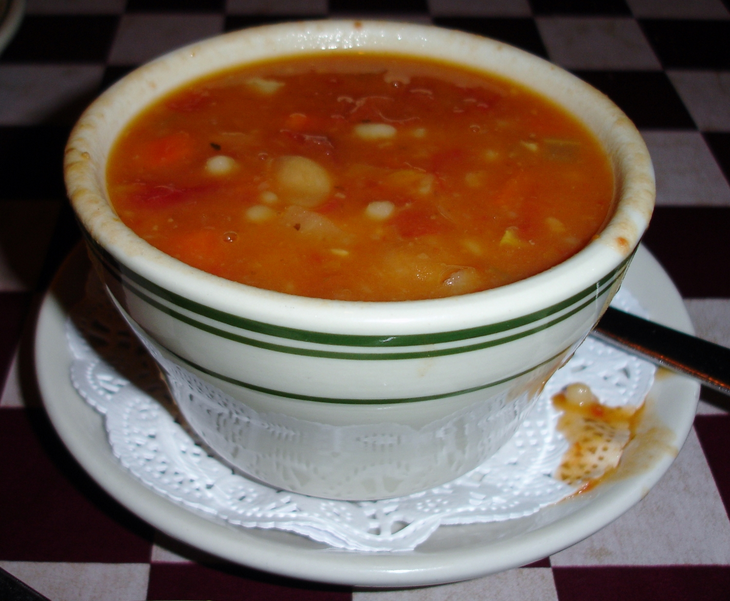 A cup of pasta e fagioli, here named pasta 'tre' fagioli because they use three kinds of beans and three kinds of pasta. Be sure to top your serving with grated cheese.
