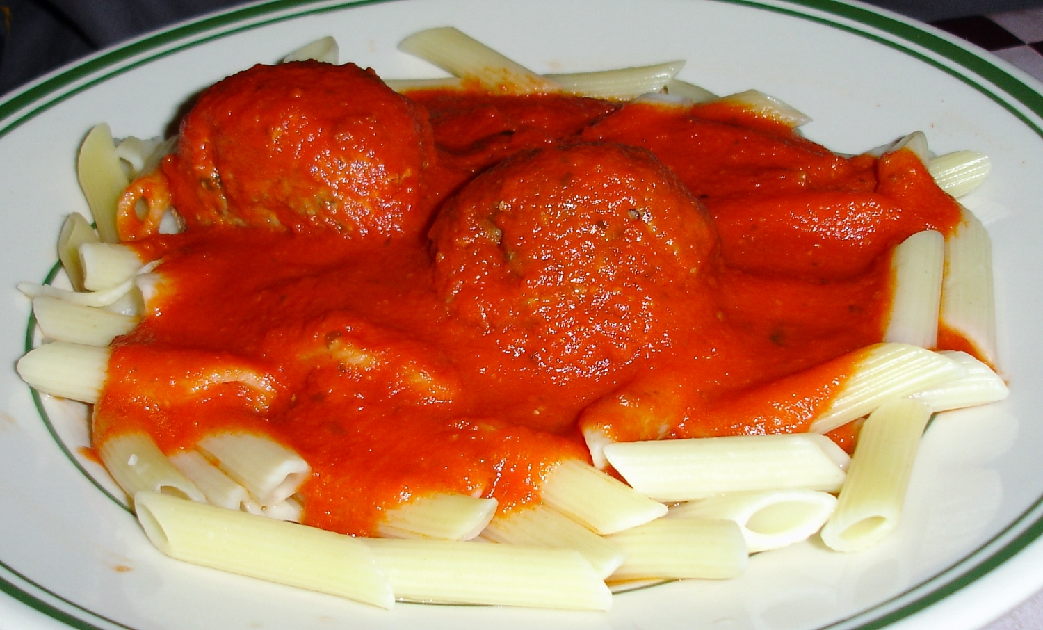 Pencil points are the patron pasta of Trenton, here topped with marinara and meatballs.