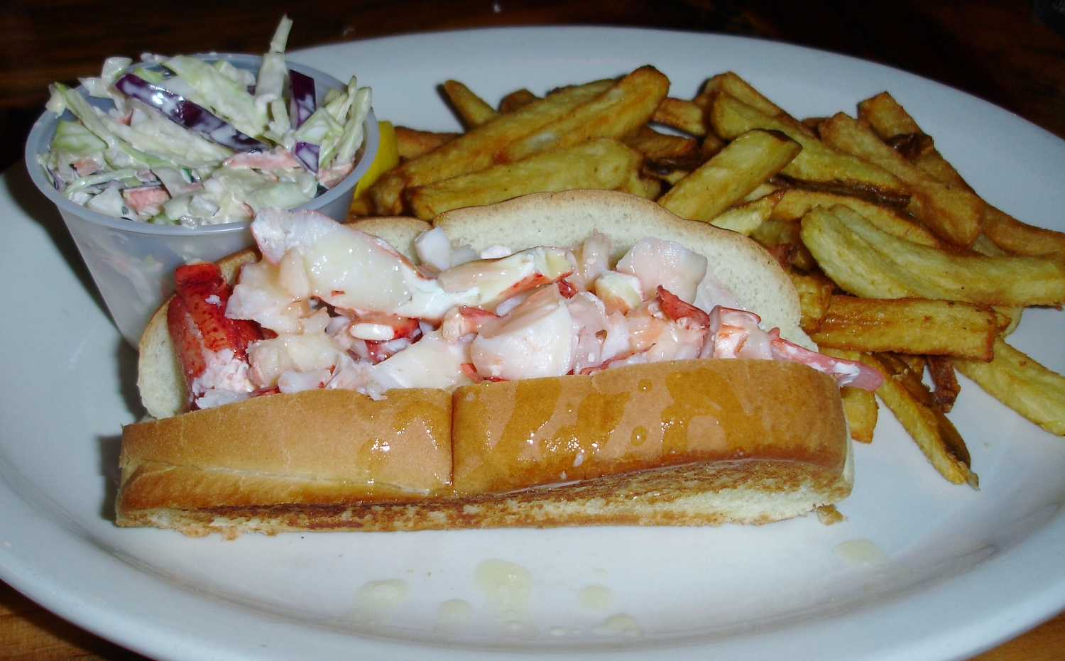 Unfortunately, all the flavor in that lobster bisque must have come at the expense of the cooked lobster because the cold meat on this daily special lobster roll was almost devoid of flavor. Too bad, because they grilled the top-loading bun beautifully, and offered the roll with melted butter. Also, their homemade slaw is excellent, as are their homemade fries.