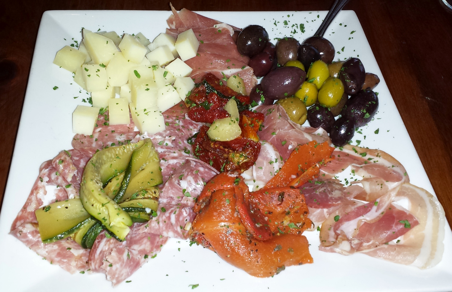 Antipasto Della Casa: assorted Italian salumi, Italian cheese, roasted red peppers, sun dried tomatoes, and olives.