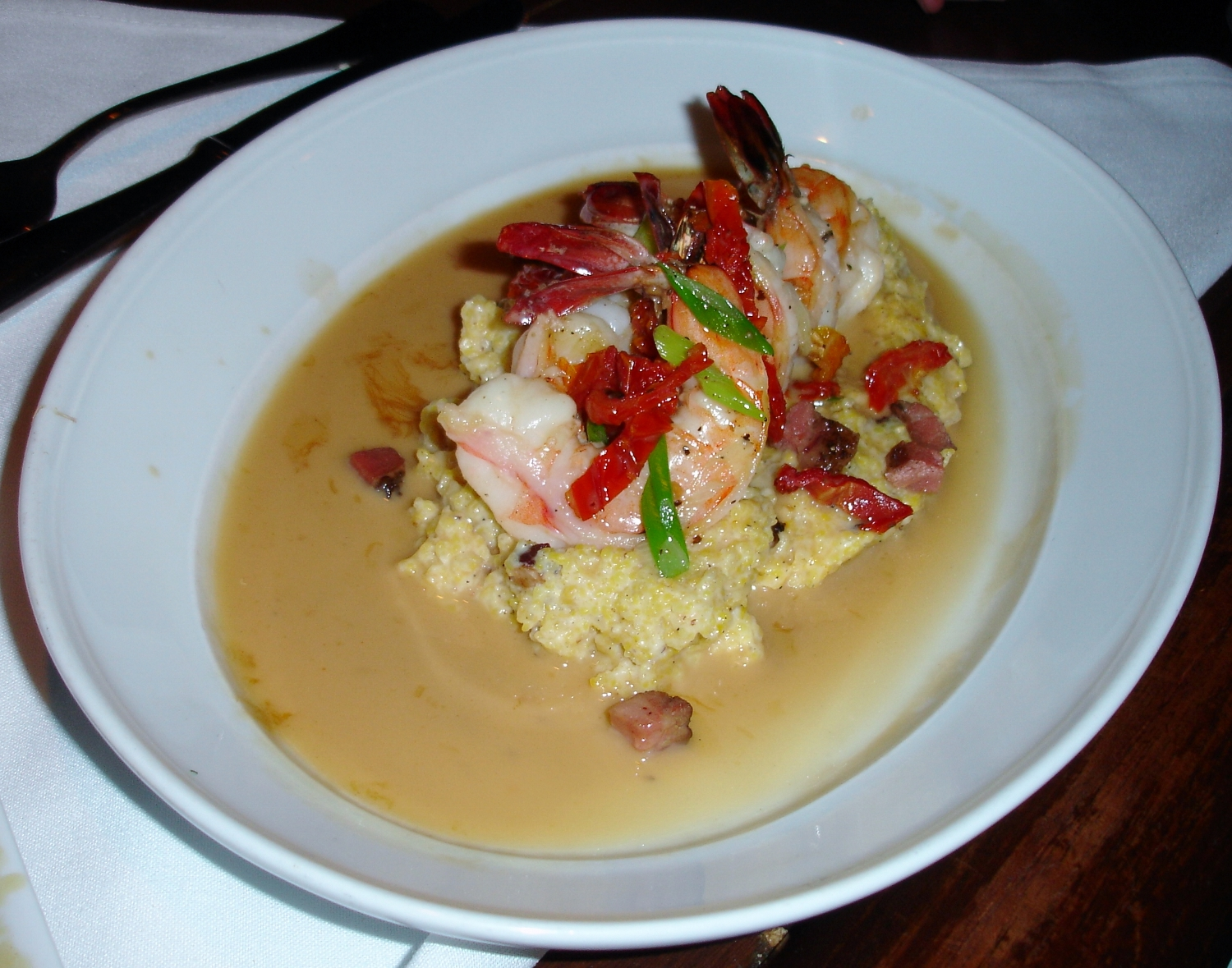 Lowcountry Shrimp and Grits is a menu staple at Trap Rock. The stone ground grits are garnished with tasso and sundried tomatoes, and are dressed with a sherry pan sauce.