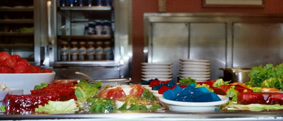 There is a kaleidoscopic assortment of options at the Jello salad section of the line. We don't know the flavor of the blue cubes of Jello, but it sure does add visual interest to the lineup, doesn't it?