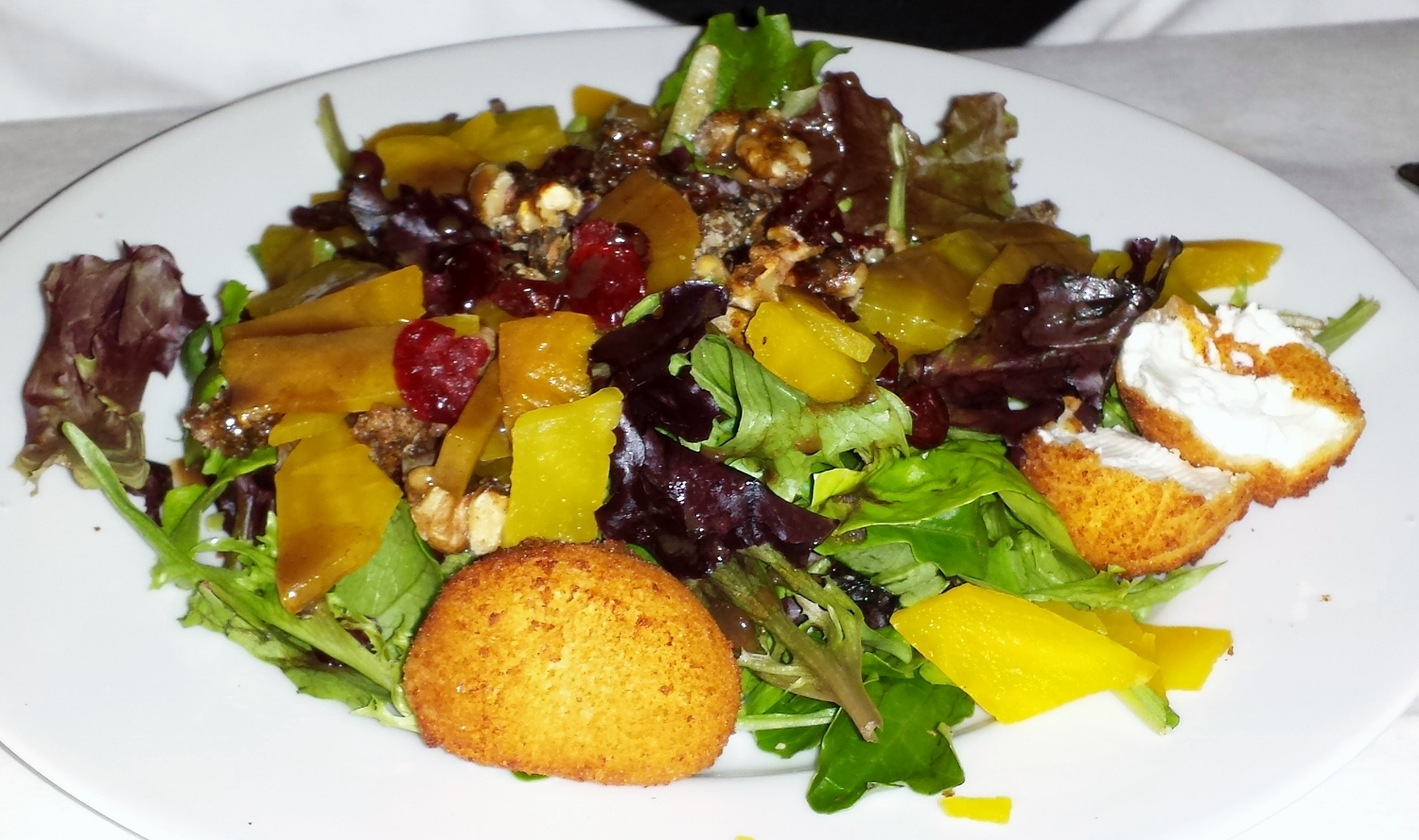 A gorgeous beet salad featured sugar-sweet golden beets, frittwers made from local chevre, walnuts candied in-house, dried cranberries, organic (of course) greens, and a maple Dijon vinaigrette.