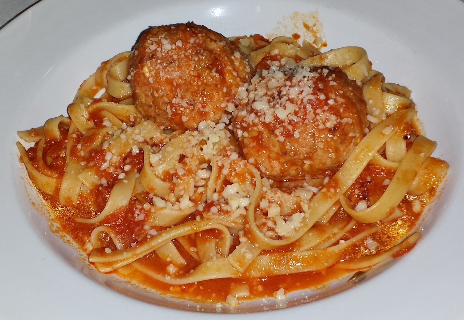 Homemade fettucine with red sauce and very light meatballs - pure comfort