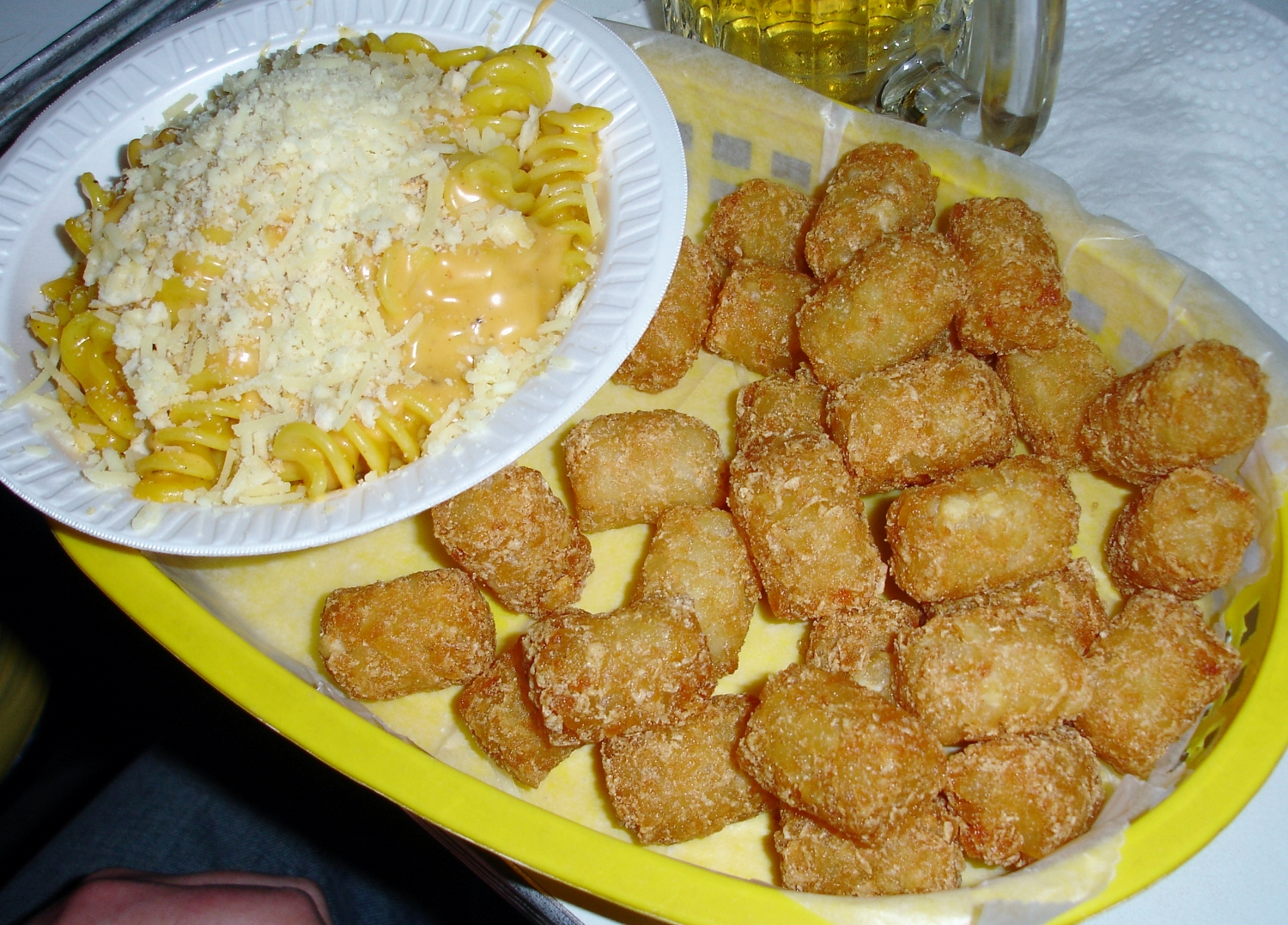 Tater Tots are the patron potato of Trailer Park Lounge. Here they are served with mac and cheese, iconoclastically based on fusilli.