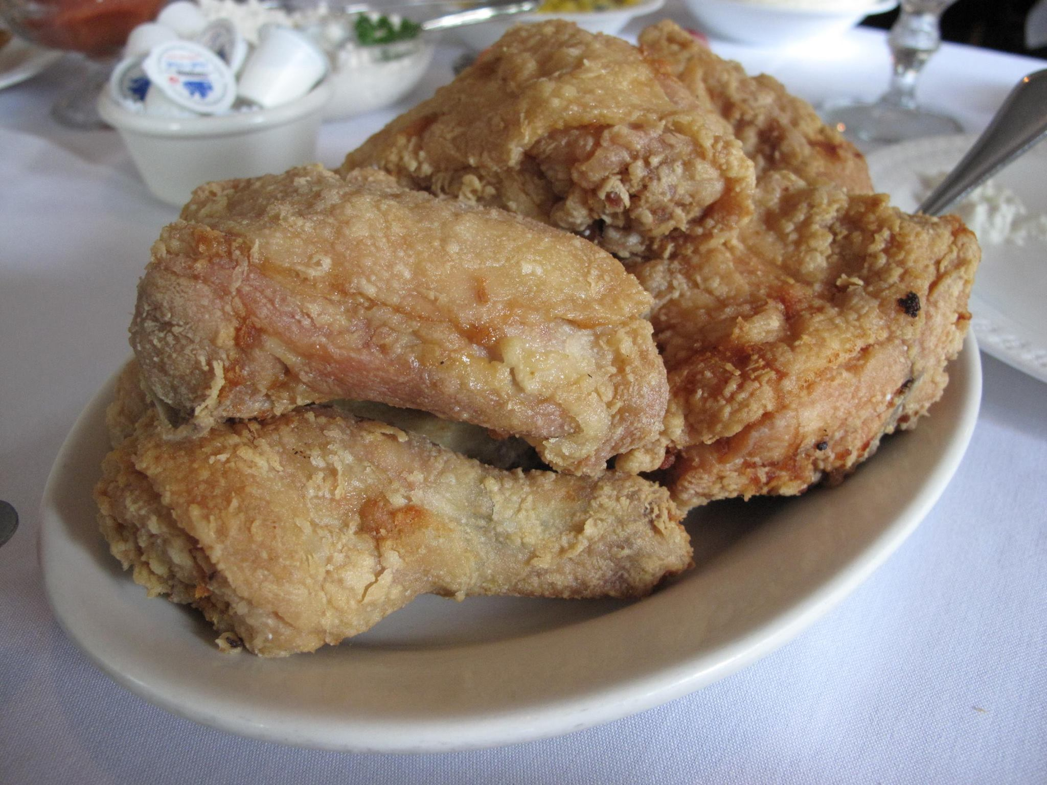 The keys to the fried chicken at Hollyhock Hill of Indianapolis, named one of America's 21 best fried chickens: fresh bird, flour coating, and lard.
