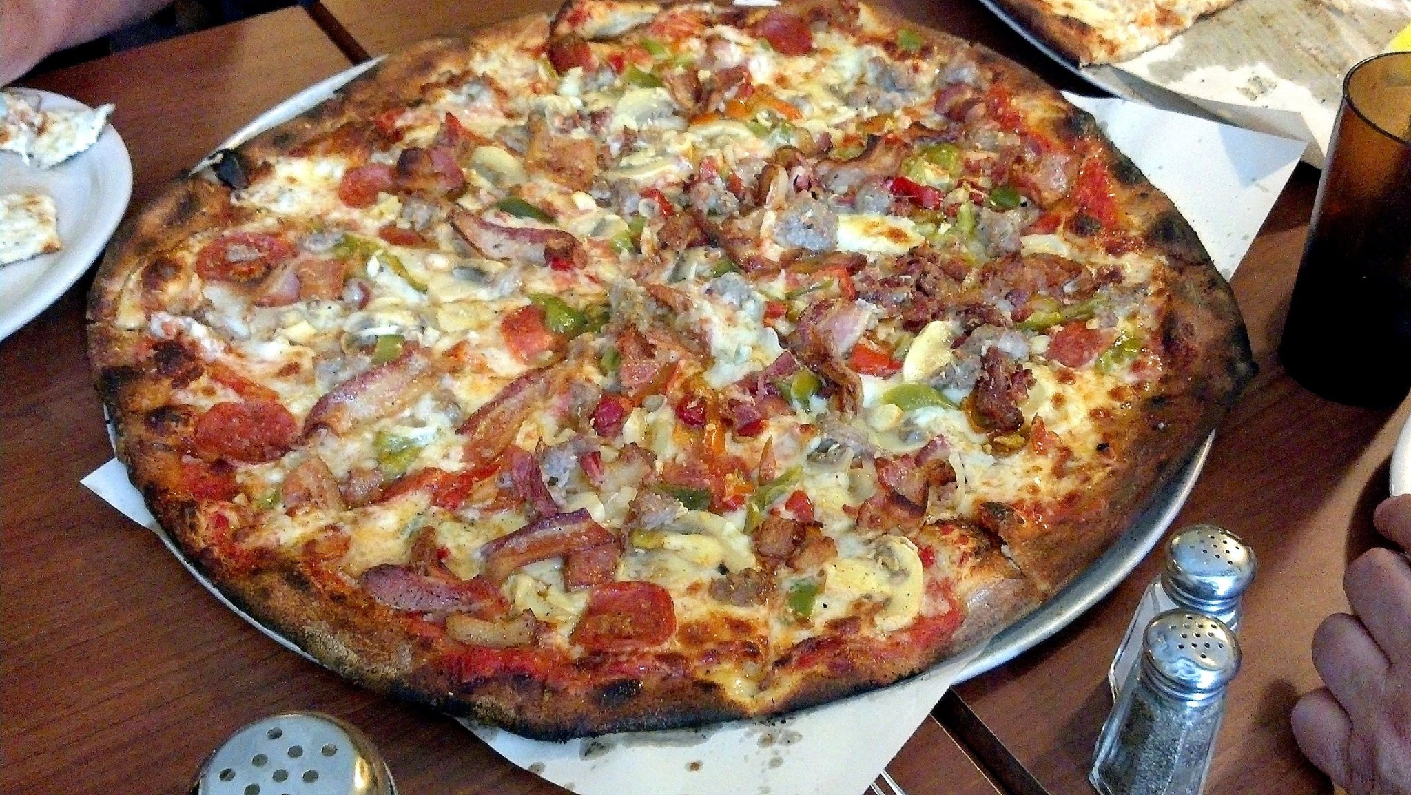 The Italian Bomb from Modern Apizza of New Haven: bacon, sausage, pepperoni, mushrooms, onions, peppers, and garlic