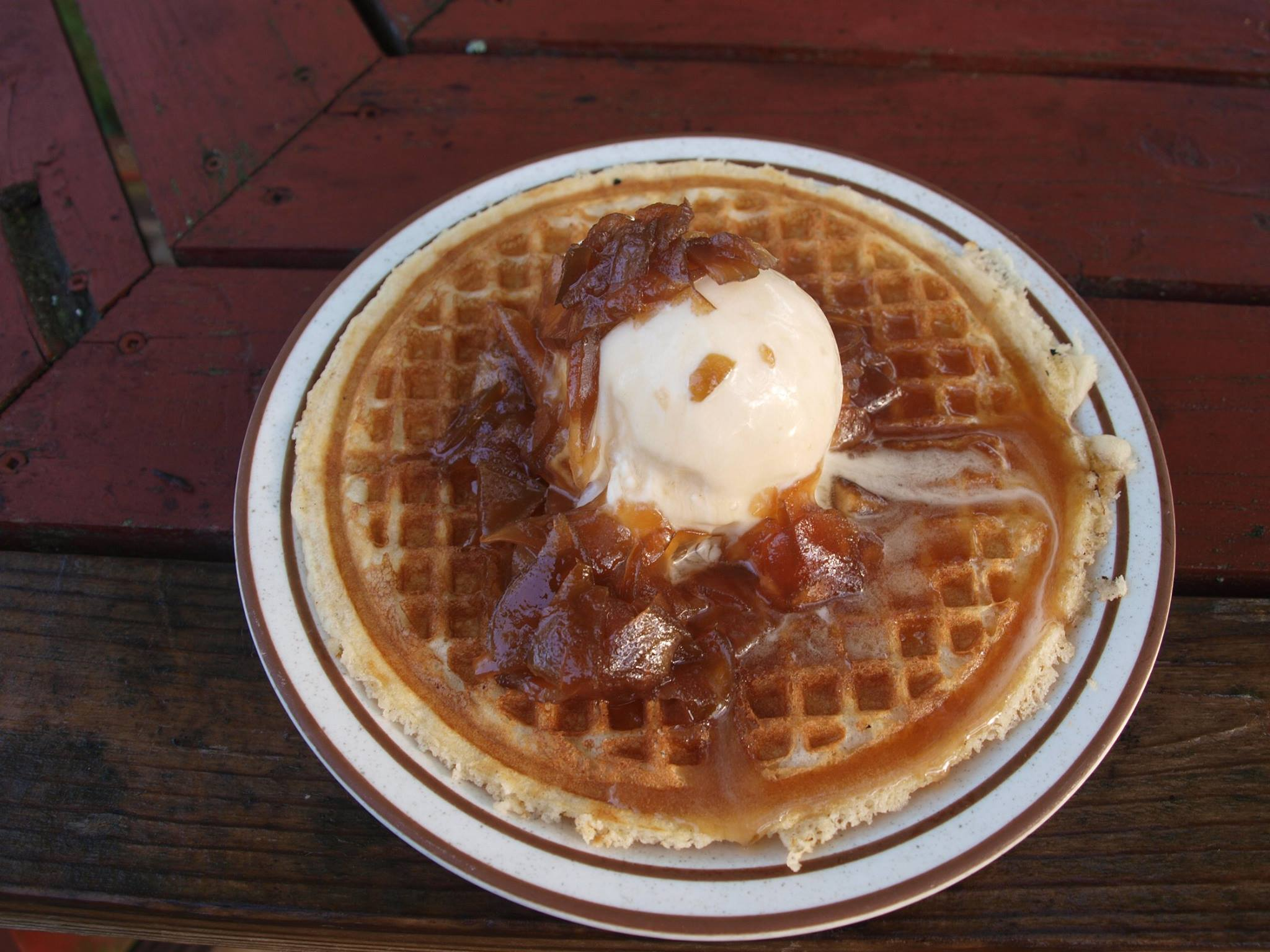 Polly's waffle is topped with their incomparable apple-and-maple Hurricane Sauce.