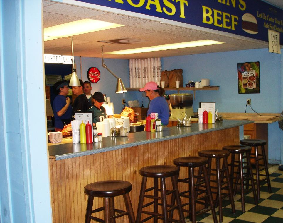 We think the counter seats are choice; there's also a dining area with waitress service.