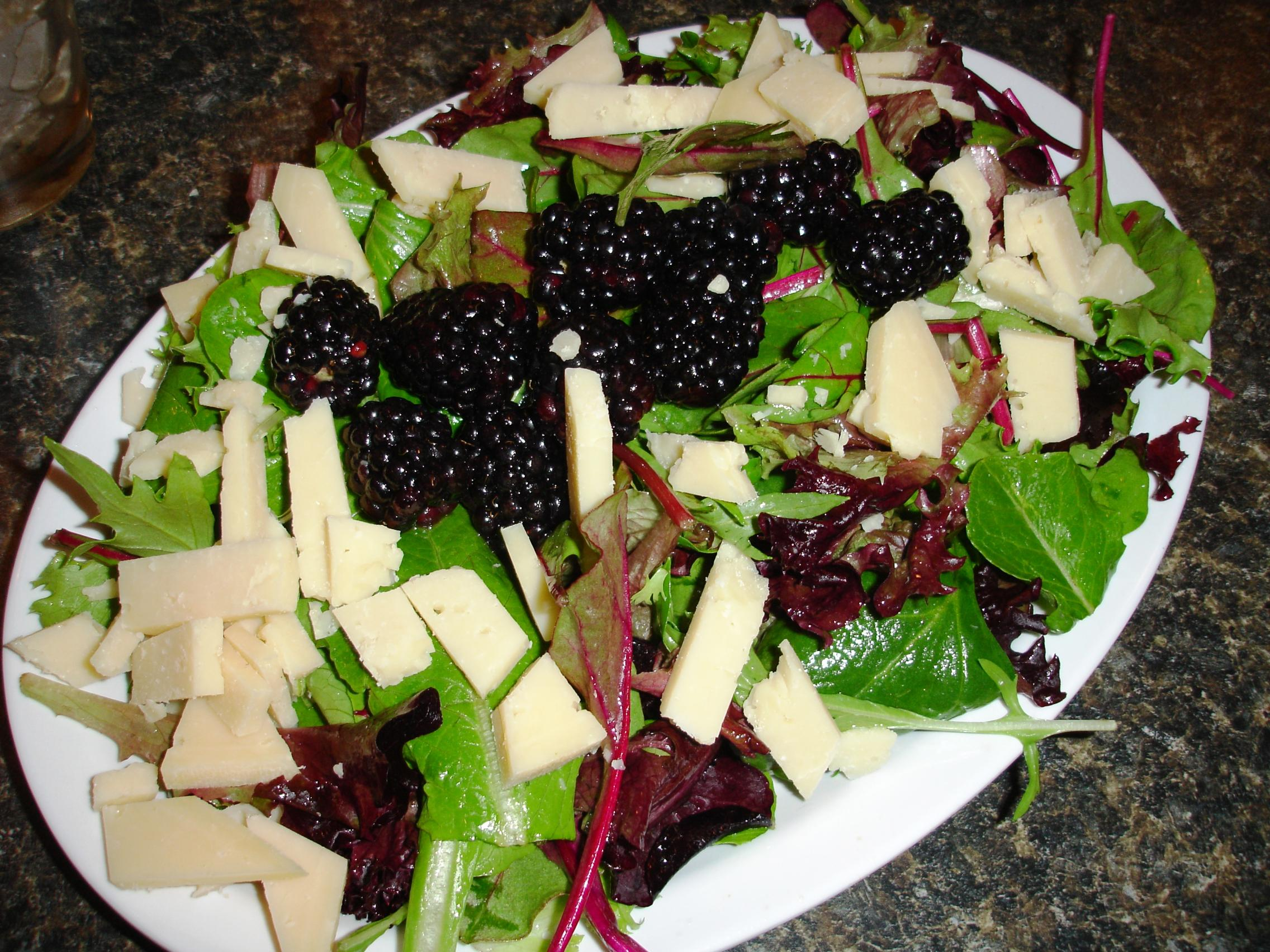 Salads vary with the season, like this one generously garnished with fresh, ripe blackberries.