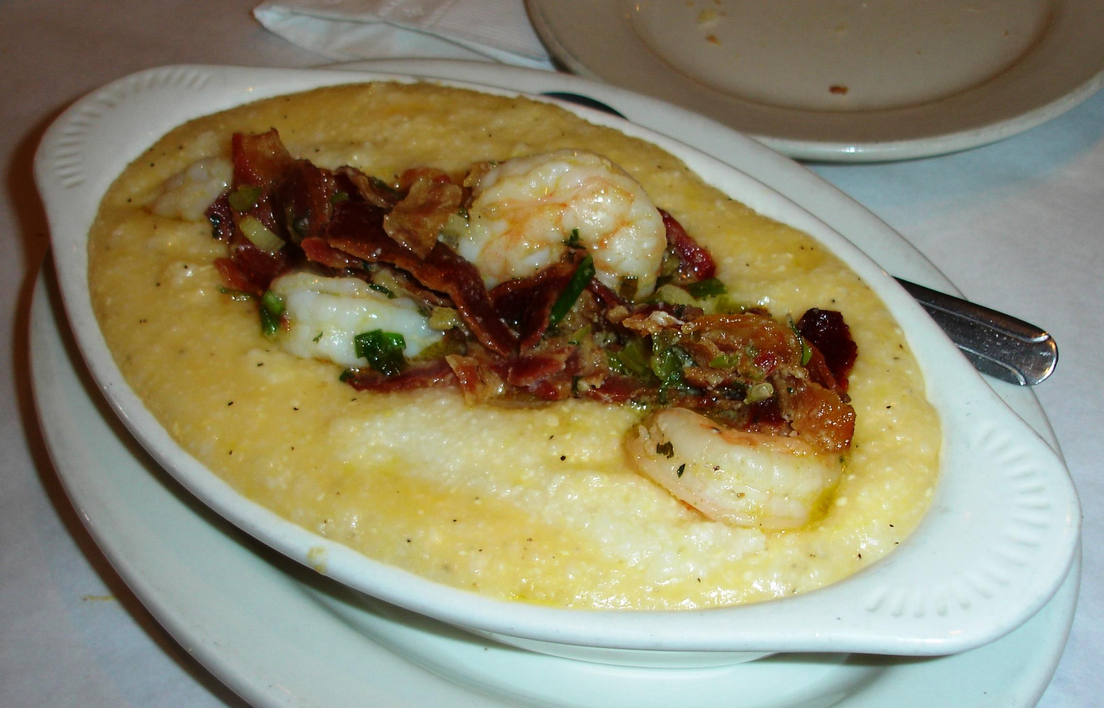 There's so much overlap between soul food and Southern food that a Carolina Lowcountry dish like Shrimp and Cheesy Grits fits right in on Pearl's menu.