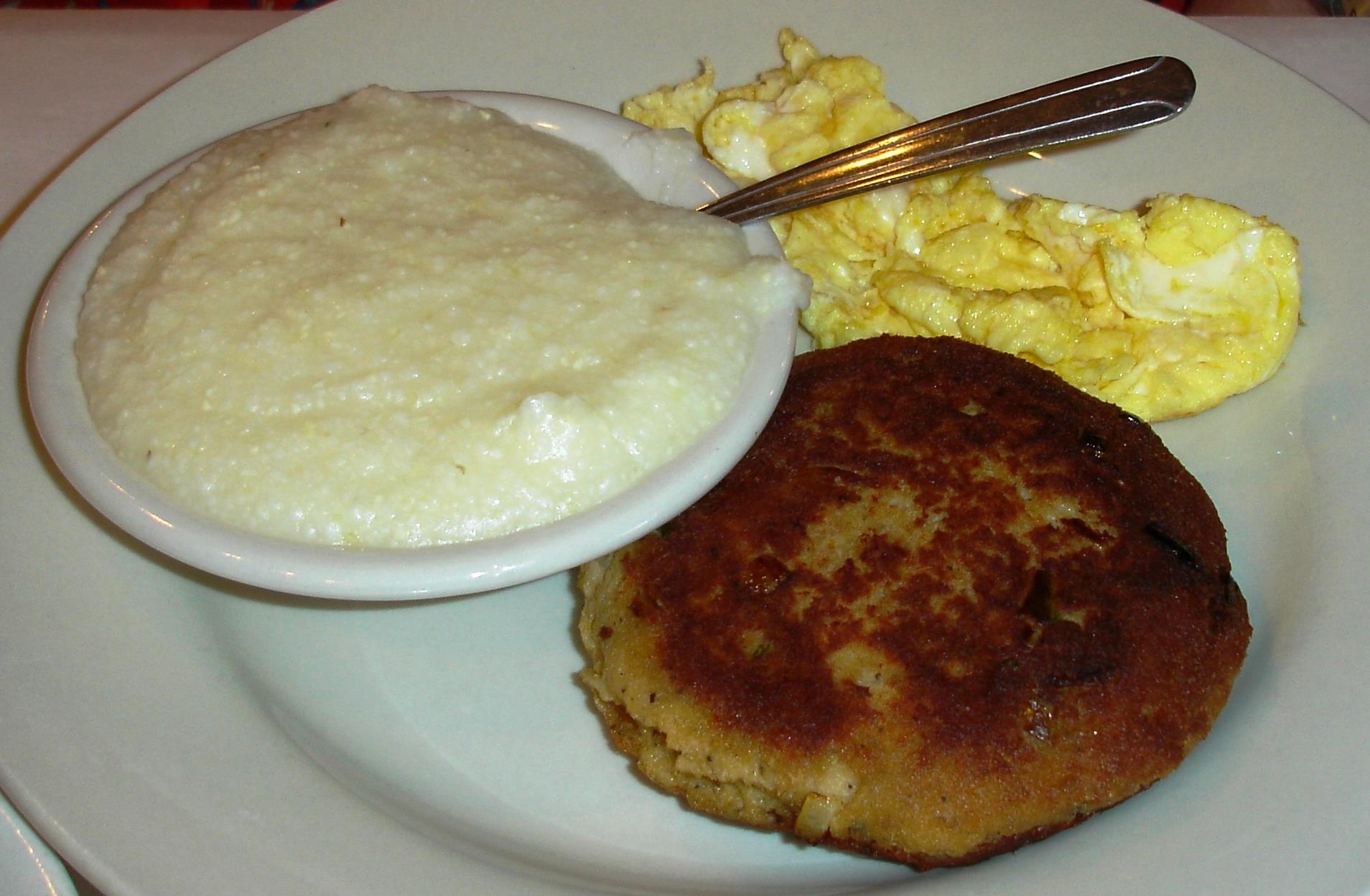 One egg, scrambled, grits, and a salmon croquette