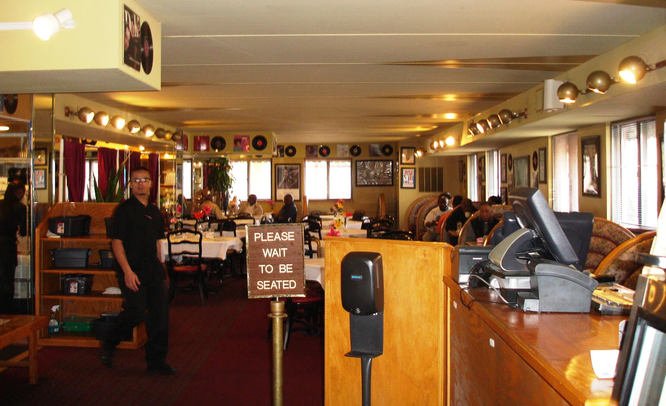 Jazz and soul classics from the '60s, on vinyl, are stuck all over the walls at Pearl's.