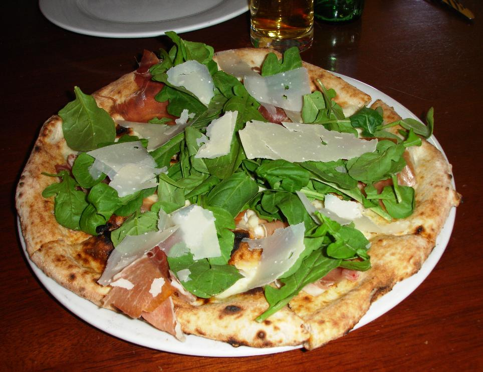 The Bianca is baked with just mozzarella and olive oil. After it's removed from the oven it receives a topping of moist raw prosciutto, impeccably fresh arugula, and shaved Parmesan. Just a fantastic pizza.