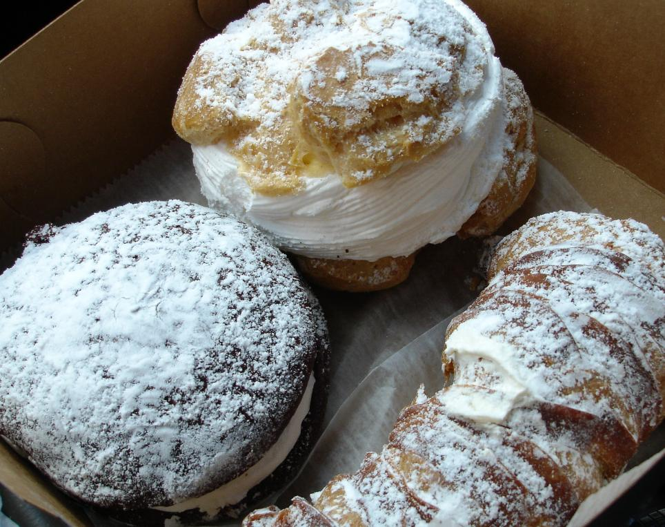 The box contains a whoopie pie, cream puff, and lobster tail. Tripoli's pastries are sweet and fresh.