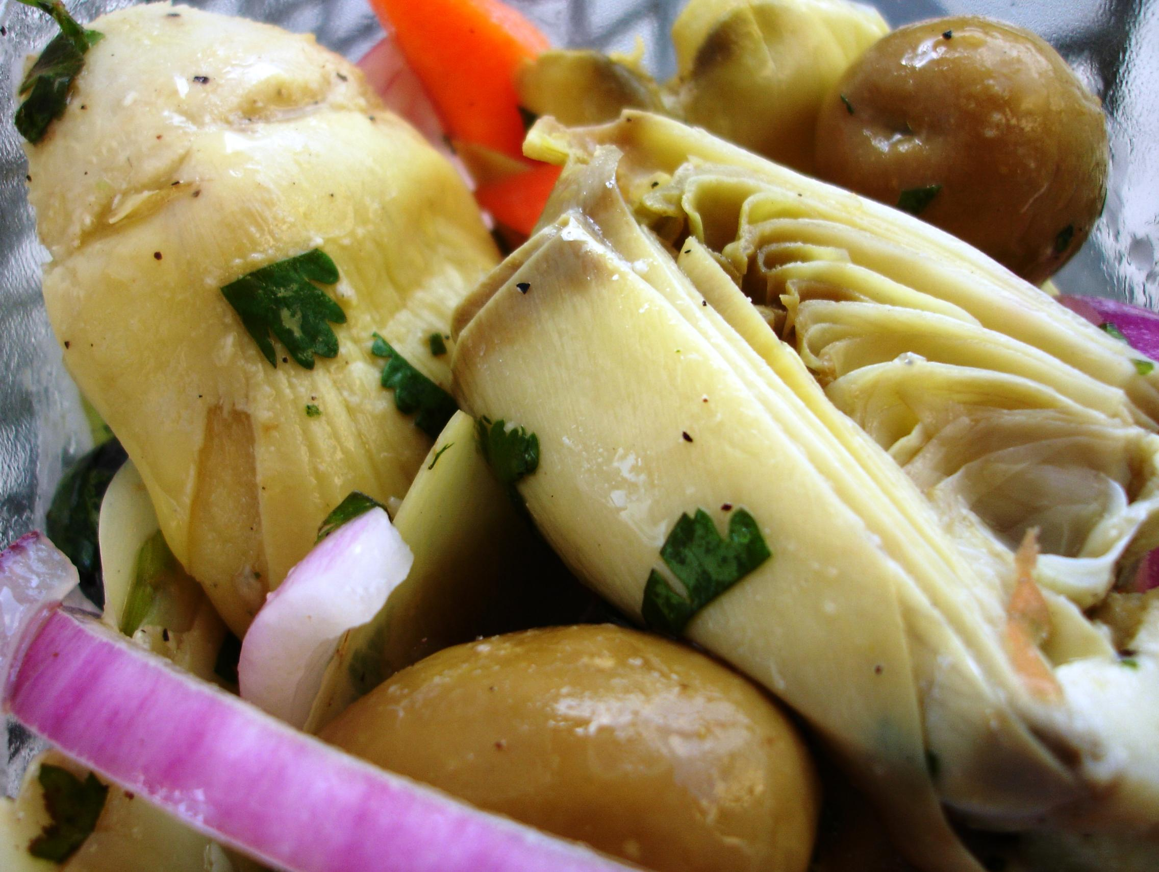 The Mediterranean Artichoke Salad adds green and black olives, carrots, celery, and onion to the artichoke hearts.