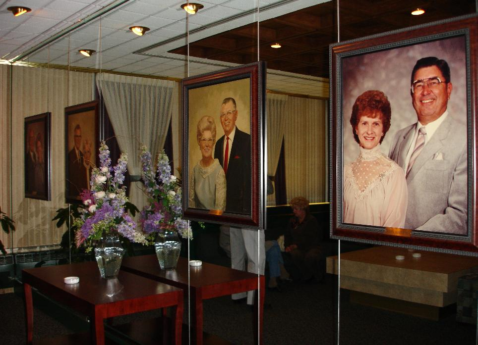 As you wait for your table you'll have a chance to admire the family portraits adorning the wall.