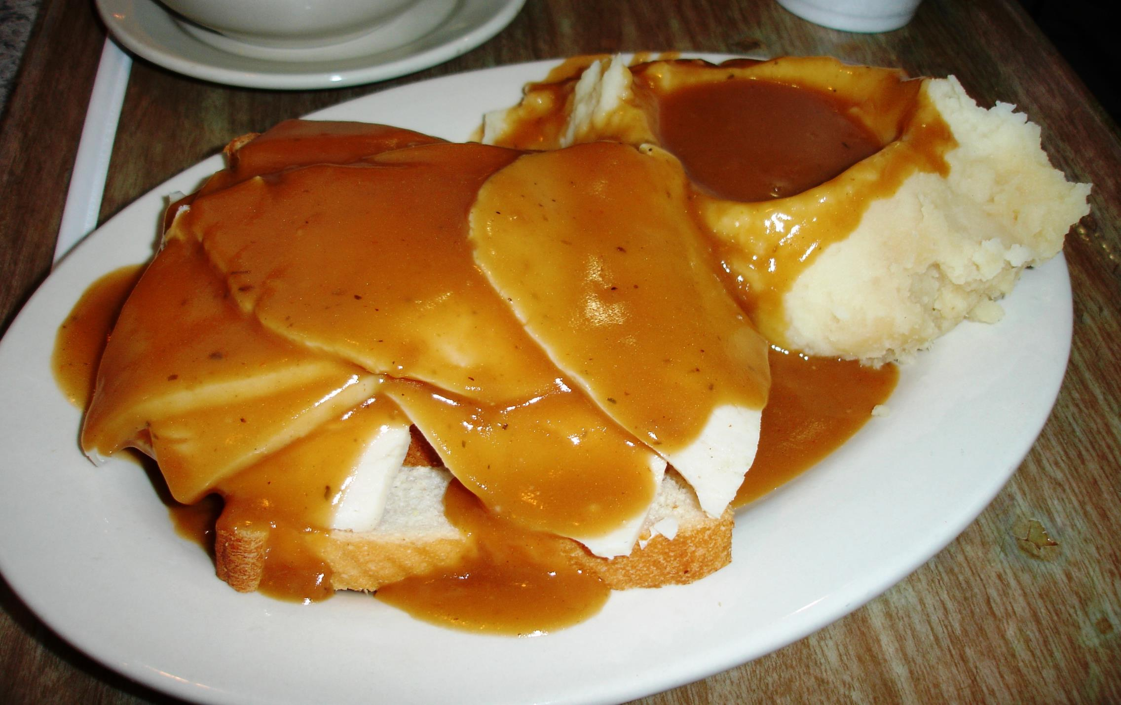 The hot turkey sandwich is made with a generous portion of real sliced turkey breast. With the potatoes and gravy, it comes at the bargain price of $5.25.