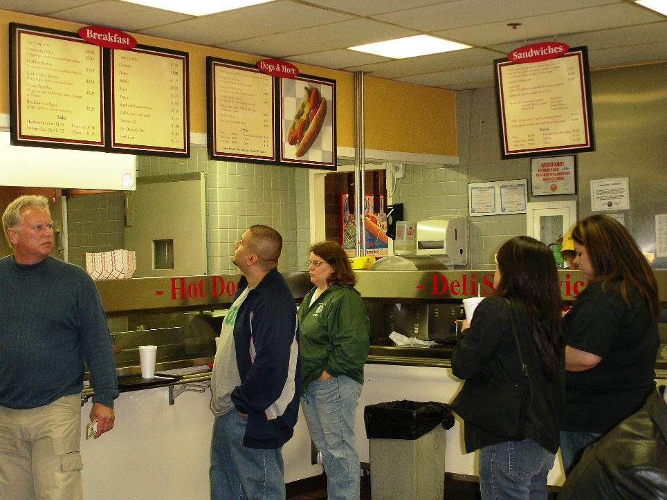 Kind of like the old Nathans, or Katz's deli in NY: find the counter that's selling what you want to eat, walk up and place your order.