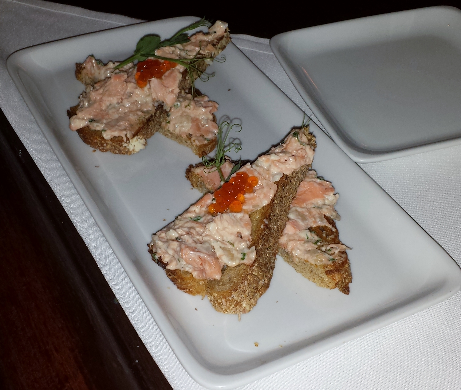 """They smoke """"craft raised"""" salmon from Skuna Bay on Vancouver Island and turn it into a dip, which is spread on toasted ale bread and topped with salmon roe. Great party food!"""