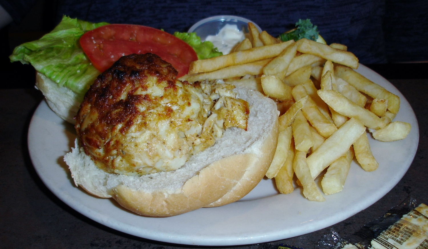 With crab cakes this good, we recommend ditching the bun and eating them forkful by delectable forkful.