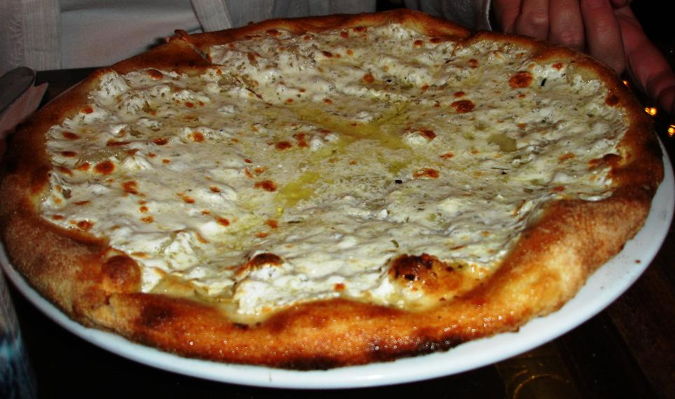 A veritable lake of their fresh mozzarella, puddles of olive oil, and garlic; not for fat phobes