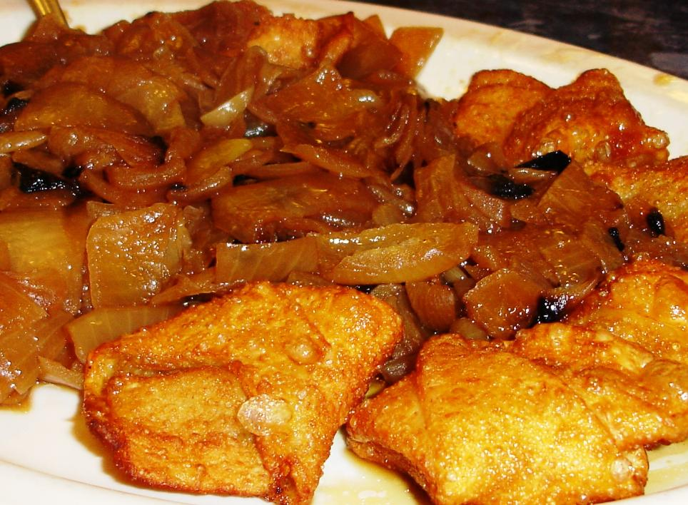 Fried kreplach come with ultrasweet, long-cooked onions.