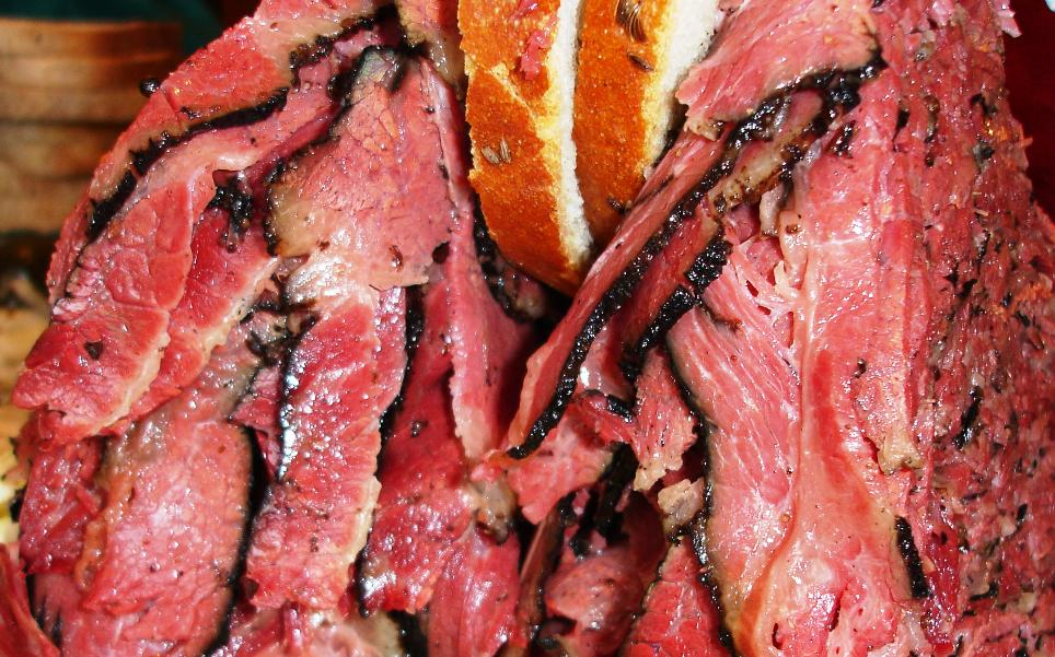 A close-up of the pastrami showcases the juiciness of the spice-edged smoky meat.